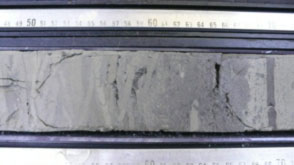 JOIDES Resolution core sample, which shows different sediments.